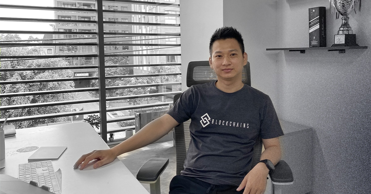 The MyConstant CEO Zon Chu sitting in his office